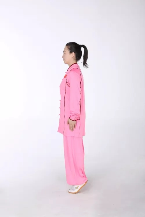 A girl in a pink dress  Description automatically generated